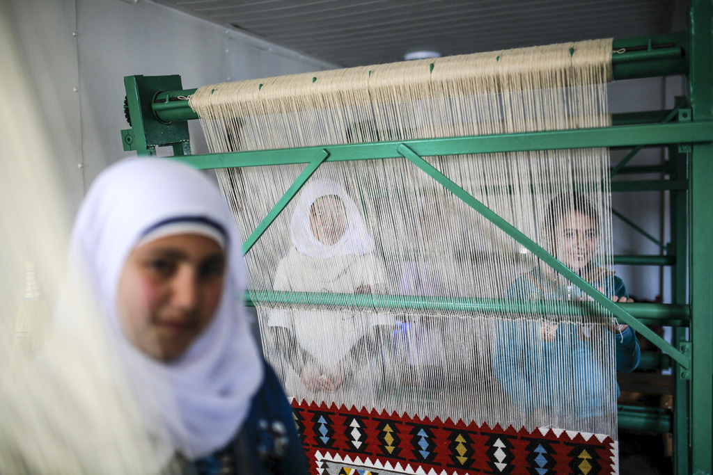 Women are seen during a visit to the Vocational Courses for women, by the BUG - Committee on Budgets Delegation of the European Parliament, at the Osmanyie refugee camp in Turkey on 10th February, 2016.