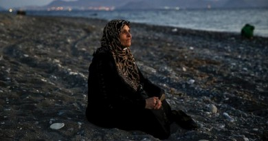 Amoun, 70, a blind Palestinian refugee who lived in the town of Aleppo in Syria, rests on a beach moments after arriving along with another 40 people on a dinghy in the Greek island of Kos, crossing a part of the Aegean Sea from Turkey to Greece, August 12, 2015. REUTERS/Yannis Behrakis