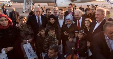 EU officials with refugees Athens relocation Avramo Twitter