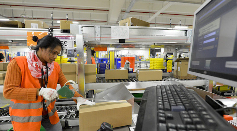 A receiver unpacks parcels at the Amazon warehouse in Graden southern Germany, on March 5, 2013.