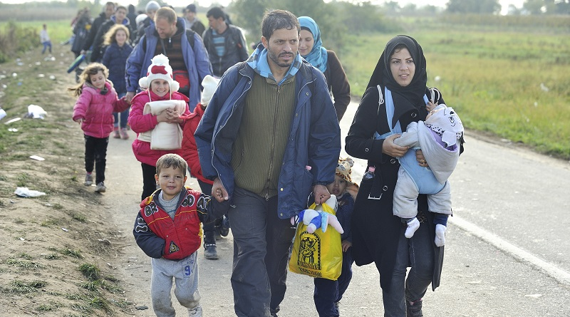 "A Syrian refugee family walks at the head of a column organised by the Croatian police, one kilometre from the border crossing with Serbia. They are being moved to buses that will take them to Opatovic Transit Center.  UNHCR works to support vulnerable families on the move, especially the many unaccompanied or separated children at risk of sickness, trauma, violence, exploitation and trafficking.   ""We are particularly concerned about the welfare of unaccompanied boys and girls on the move and unprotected across Europe, many of whom have experienced the horrors of war and considerable hardship in making these journeys alone,"" says UNHCR Assistant High Commissioner for Protection Volker Türk. ; More than 643,000 refugees and migrants arrived in Europe via the Mediterranean sea this year, including 502,500 in Greece only. Many of the refugees and migrants are desperate to move quickly onwards to Western Europe, fearing that borders ahead of them will close."